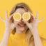 women is holding lemons